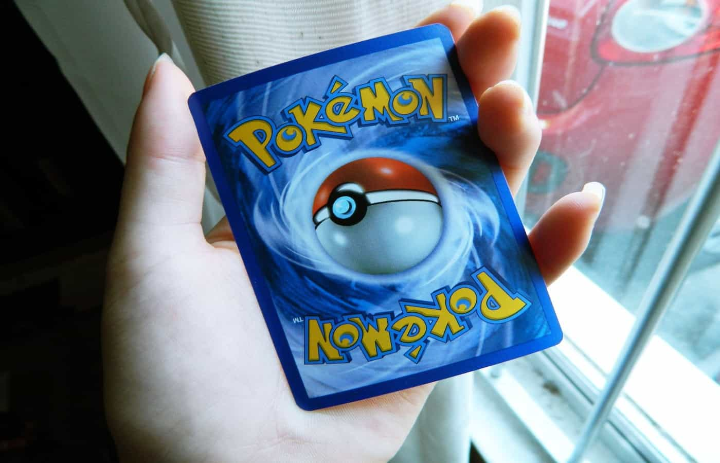 how to fix a bent pokemon card