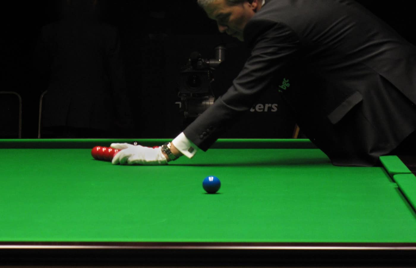 why do snooker players tap the table