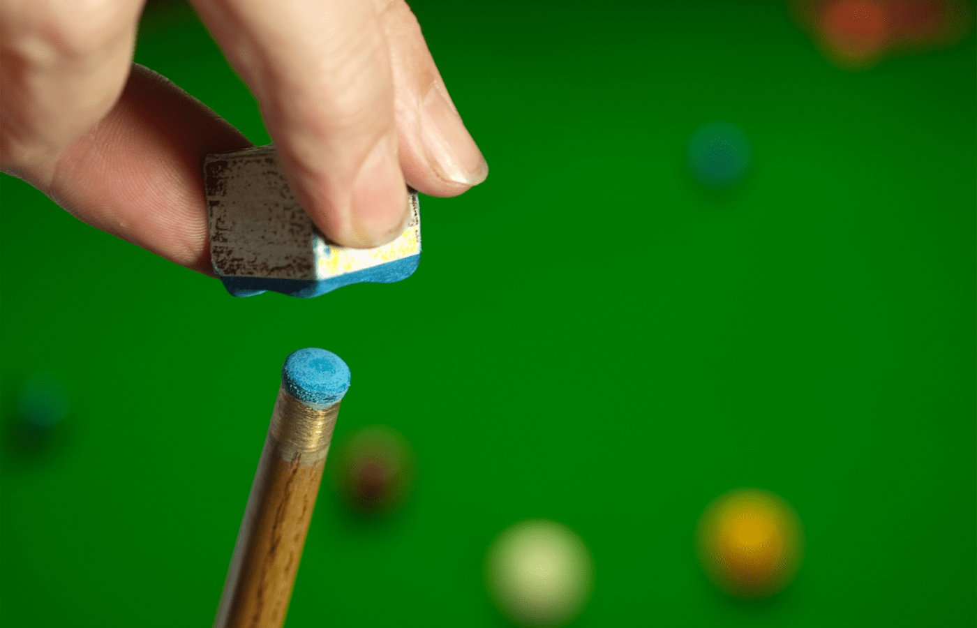 why do snooker players chalk their cue so much