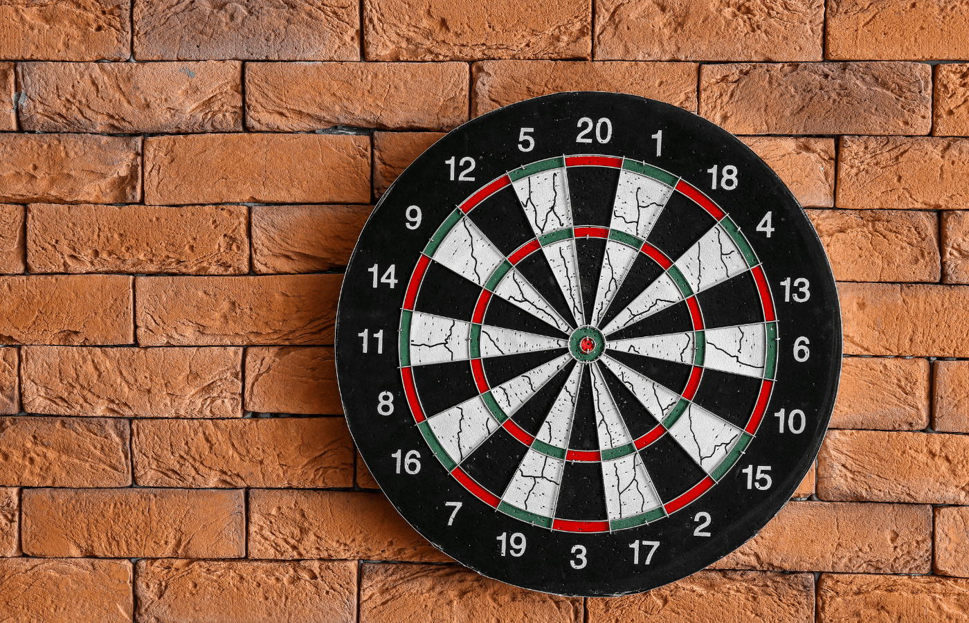 how to hang a dartboard on brick