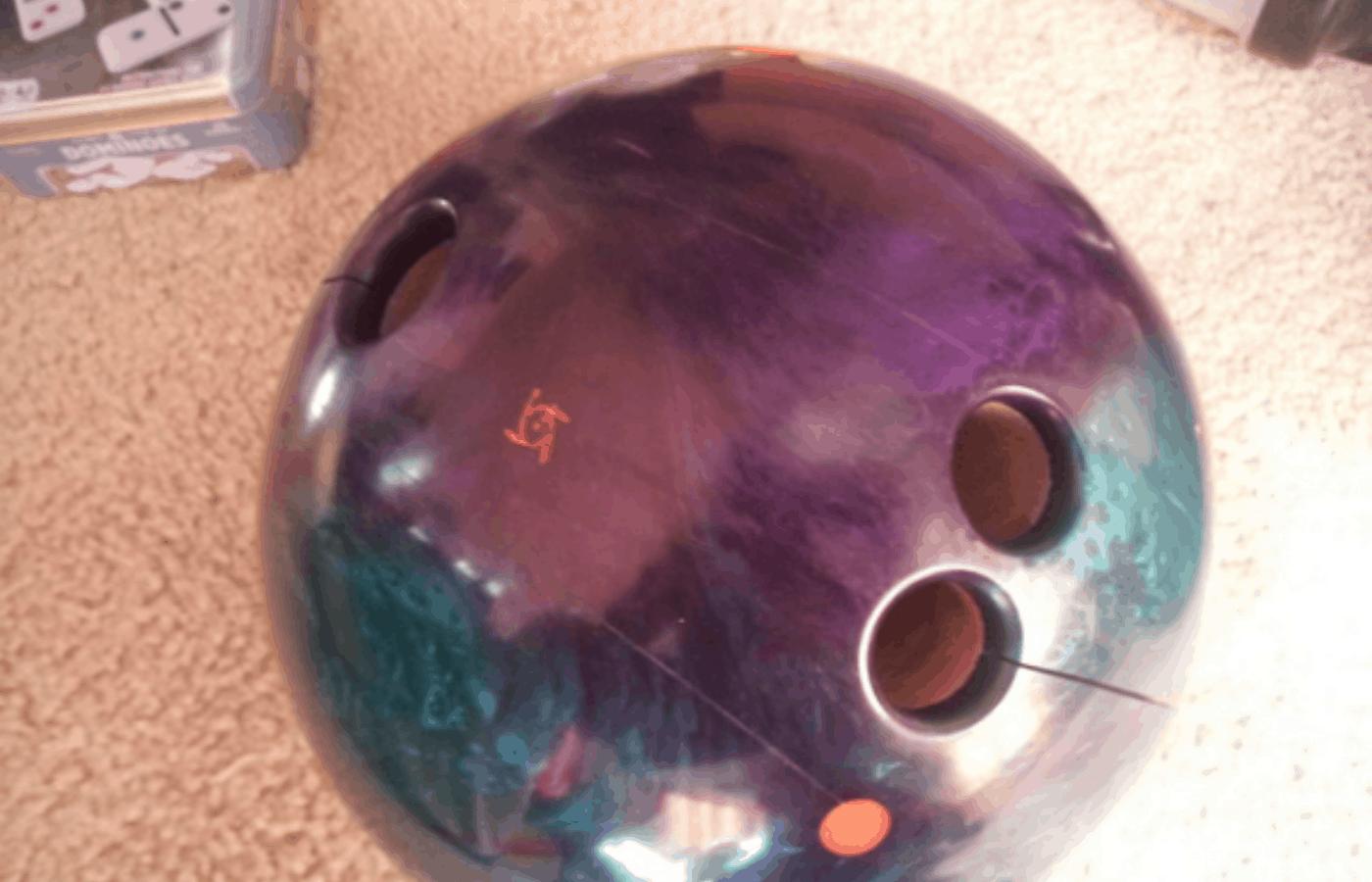 why do bowling balls crack