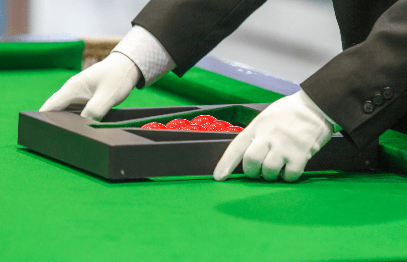why do snooker referees wear white gloves