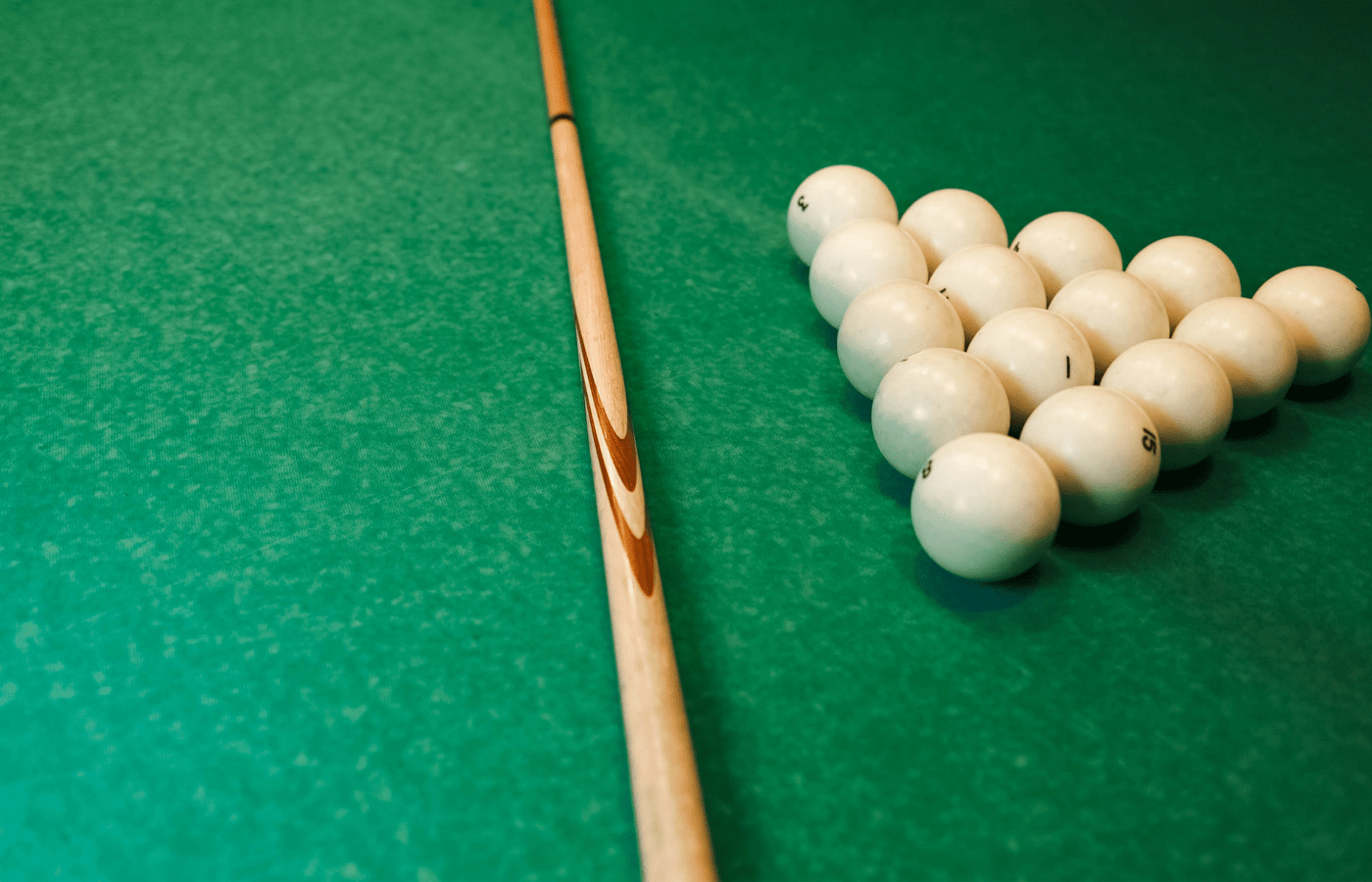 how to get adhesive off a pool cue