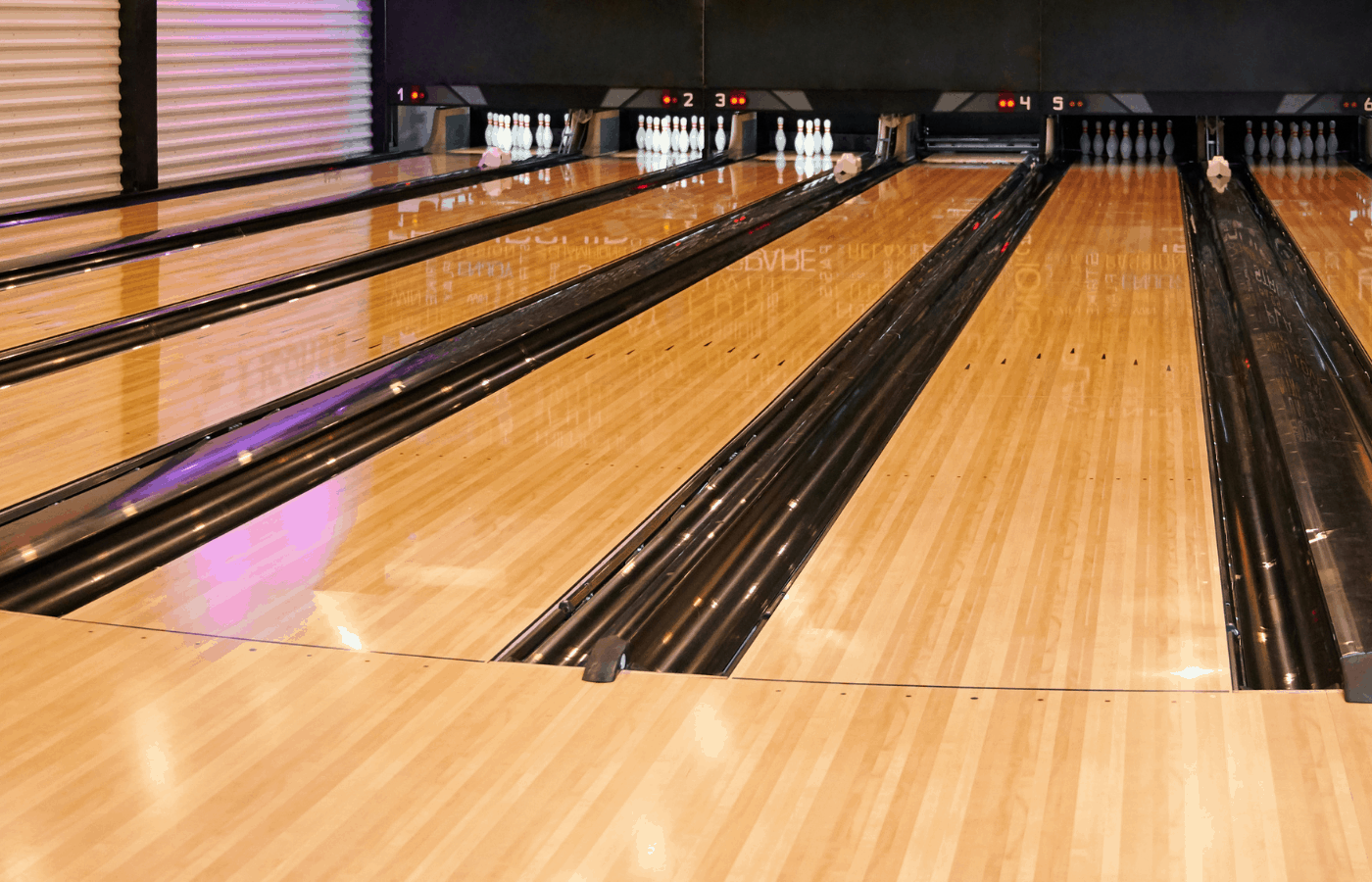 what makes bowling lanes slippery